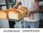 freshly baked artisan bread ...   Shutterstock . vector #1046991424