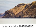 the rolling mountains at rapid...   Shutterstock . vector #1047014935
