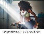 strong african american woman... | Shutterstock . vector #1047035704