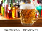 mug of beer in a bar | Shutterstock . vector #104704724