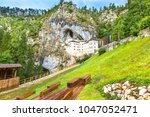 predjama castle in slovenia.... | Shutterstock . vector #1047052471