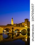the ponte pietra has the adige... | Shutterstock . vector #1047056557