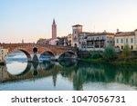 city of verona with adige river ... | Shutterstock . vector #1047056731