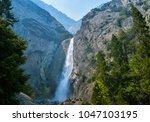 bridal veil falls in yosemite... | Shutterstock . vector #1047103195