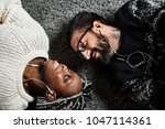 couple listening to music... | Shutterstock . vector #1047114361