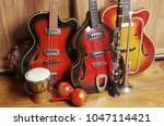 three jazz guitars and other... | Shutterstock . vector #1047114421