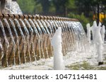 fountain in city park on hot...   Shutterstock . vector #1047114481