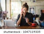 asian woman call to bank call...   Shutterstock . vector #1047119335