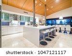 luxury kitchen with stone bench ... | Shutterstock . vector #1047121117