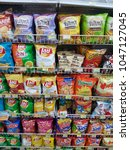 Small photo of Bangkok, Thailand - March 14, 2018: A shelf of snack products in 7-11, a famous convenient store with over 10,000 across the country.