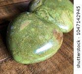 green opal crystal heart on... | Shutterstock . vector #1047142945
