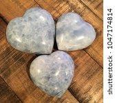 blue calcite crystal heart on... | Shutterstock . vector #1047174814