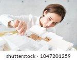 woman making a model of a...   Shutterstock . vector #1047201259