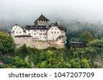 the vaduz castle under the... | Shutterstock . vector #1047207709