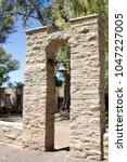 Small photo of Antique bell in in stone bell arch tower used to indicate times on farm in Karoo South Africa