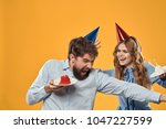 man and woman with a cake and... | Shutterstock . vector #1047227599