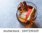 apple cider whiskey cocktail... | Shutterstock . vector #1047250105