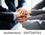 business teamwork group putting ... | Shutterstock . vector #1047269761