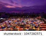 night view of the train night... | Shutterstock . vector #1047282571