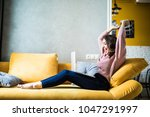 woman raising her hands up on... | Shutterstock . vector #1047291997