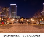 tokyo station and business... | Shutterstock . vector #1047300985
