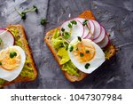 toast with avocado  egg and... | Shutterstock . vector #1047307984