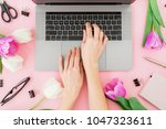 woman typing on laptop. woman...   Shutterstock . vector #1047323611