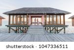two in a bungalow at sunset | Shutterstock . vector #1047336511