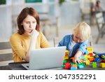 adorable little boy playing...   Shutterstock . vector #1047352291