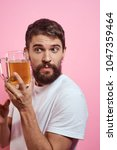 man with a mug of beer  alcohol ... | Shutterstock . vector #1047359464