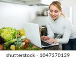 portrait of busy young woman...   Shutterstock . vector #1047370129