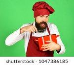 man with beard holds...   Shutterstock . vector #1047386185
