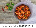 stewed broad beans in tomato... | Shutterstock . vector #1047389311