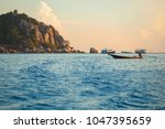 long tail boat floating over... | Shutterstock . vector #1047395659