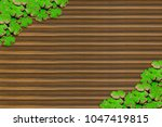 Small photo of floral arrangement clover spring holiday irish day saint patricks on a ribbed wooden surface with ornamentation in the corners