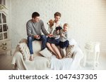 portrait of happy family with... | Shutterstock . vector #1047437305