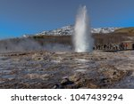 hot springs and geyser at... | Shutterstock . vector #1047439294