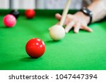 asian man playing snooker game  ... | Shutterstock . vector #1047447394