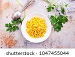 sweet corn  corn in bowl on a... | Shutterstock . vector #1047455044