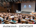 speaker giving a talk on... | Shutterstock . vector #1047472699