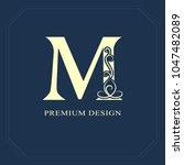 capital  letter m. calligraphic ...   Shutterstock .eps vector #1047482089