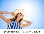 portrait of a beautiful woman... | Shutterstock . vector #1047485275