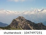 Small photo of View of a high peak in Italian Alps - Dolomites on a sunny day in spring with mountain chain in background