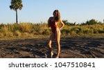 beautiful young blonde woman... | Shutterstock . vector #1047510841