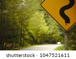 Closeup Of A Road Sign With A...