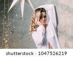 portrait of a blonde in a shirt. | Shutterstock . vector #1047526219