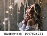portrait of a blonde in a shirt. | Shutterstock . vector #1047526231