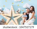 happiness and beautiful family | Shutterstock . vector #1047527179