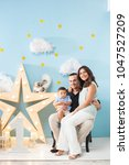happiness and beautiful family | Shutterstock . vector #1047527209
