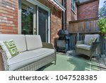 backyard garden of custom built ... | Shutterstock . vector #1047528385